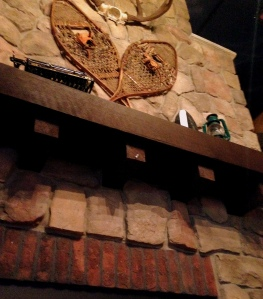 Stone Fireplace and vintage snowshoes at Bud's of Interlochen
