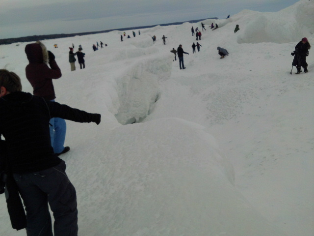 People out on frozen Lake Michigan at the ice caves