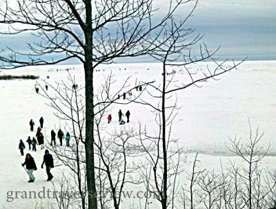 people walking out on frozen lake michigan ice