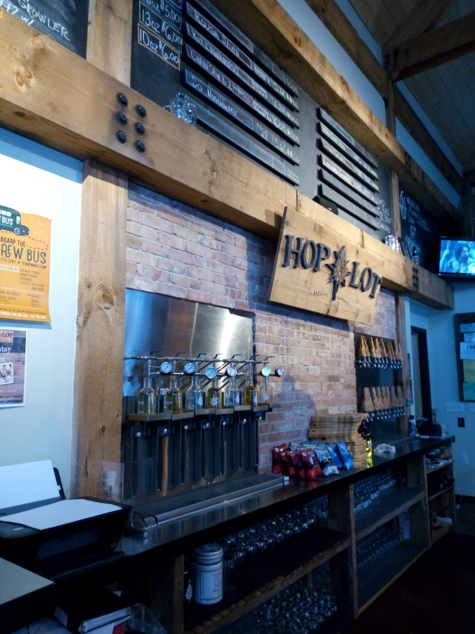 Ordering beer at the bar at Hop Lot Brewing Company in Sutton's Bay Michigan